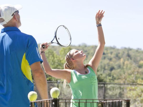 Two people playing tennis.
