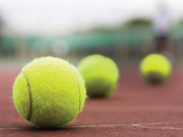 Close photo of tennis balls.