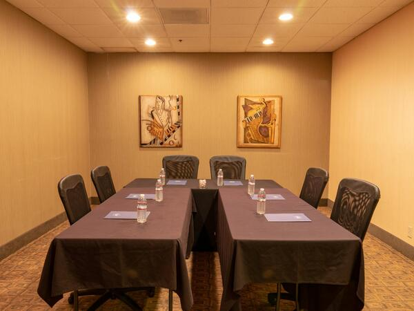Conference room with U-shaped table.
