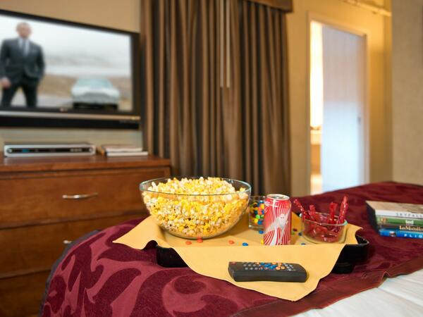 Tray with popcorn on bed