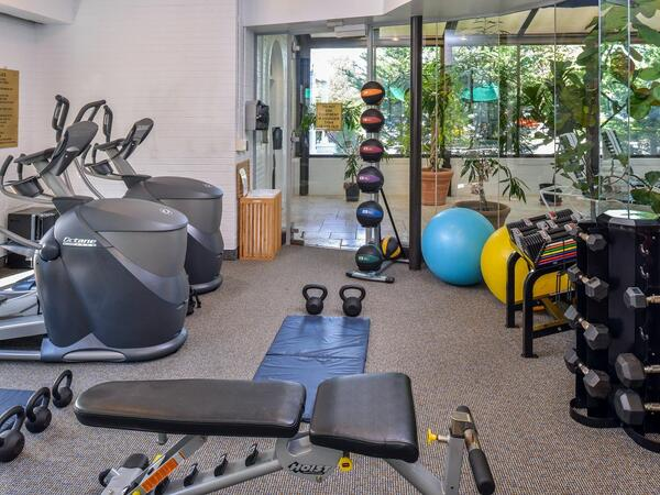 Fitness center with multiple workout machines