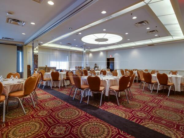 Event space set with banquet rounds.