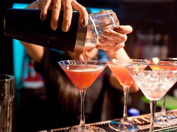 Bartender mixing cocktails.