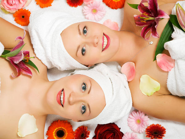 two women in towels covered in flowers