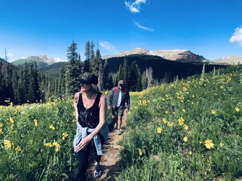 hiking through yellow flowers