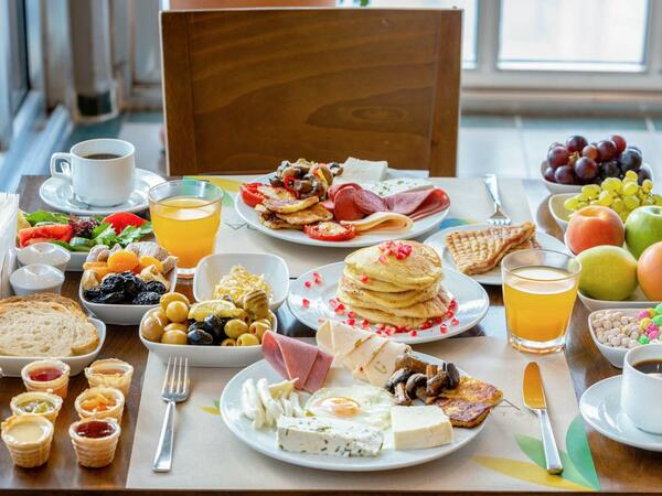 Table Laid With Assorted Breakfast Food