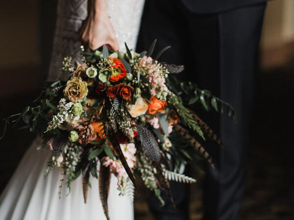 A wedding bouquet held by the bride