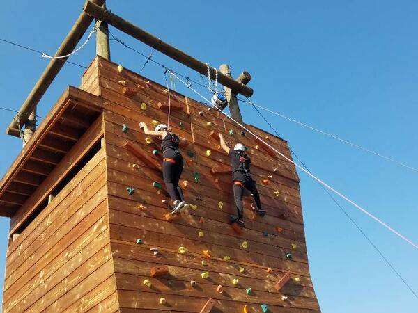Two people on climbing wall