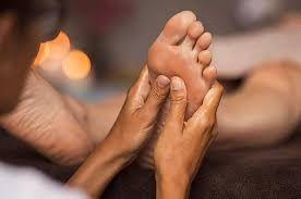 person massaging feet