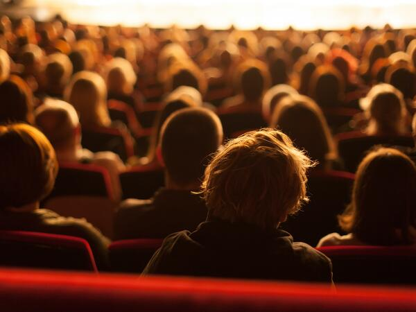 A gathering of people at a theatre