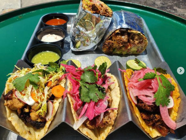 A plate of Tacos at - Taqueria uptown 66