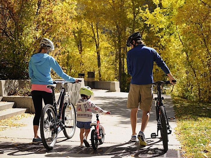 Family walking bikes
