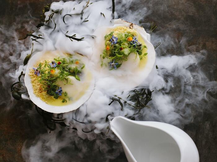 Scallops served under a delicate mist