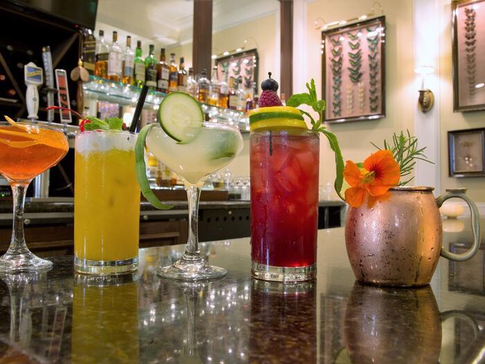 Line of cocktails on a bar
