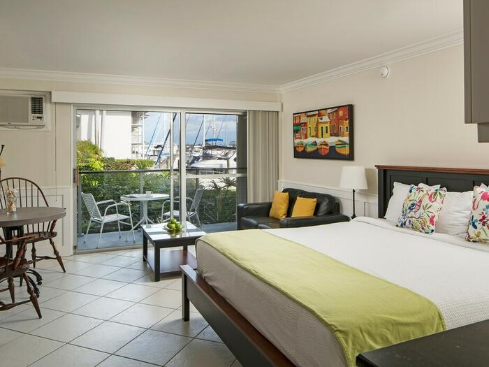 King bed guest room with balcony.