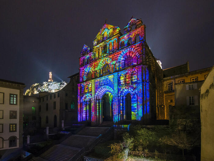 A building decroated with colorful lights in Bristol