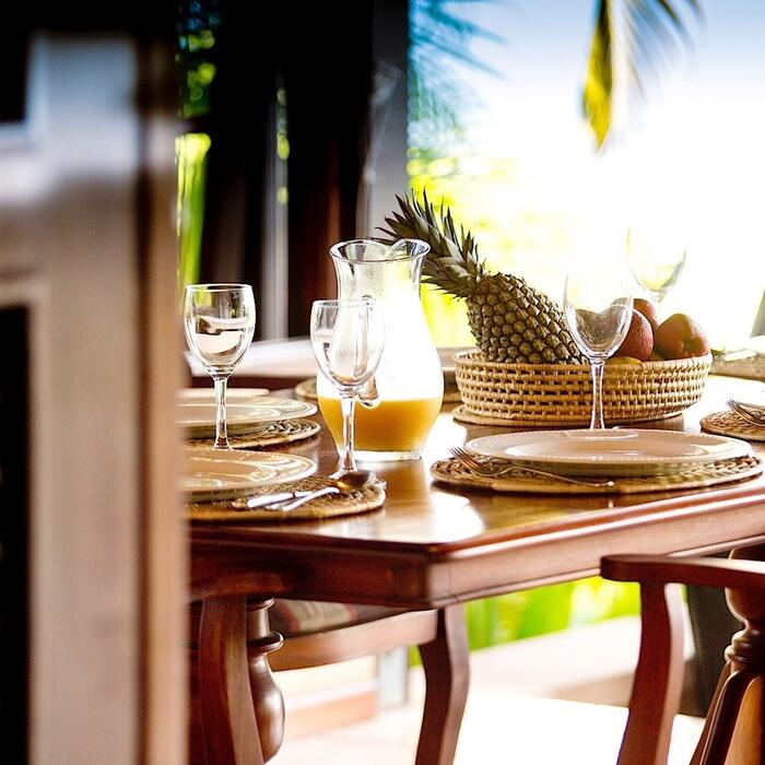 Dining table with tropical accoutrements