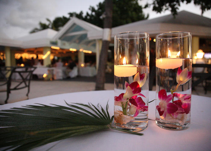 Centerpieces with floating candles and palm leaf at Tamarind Re