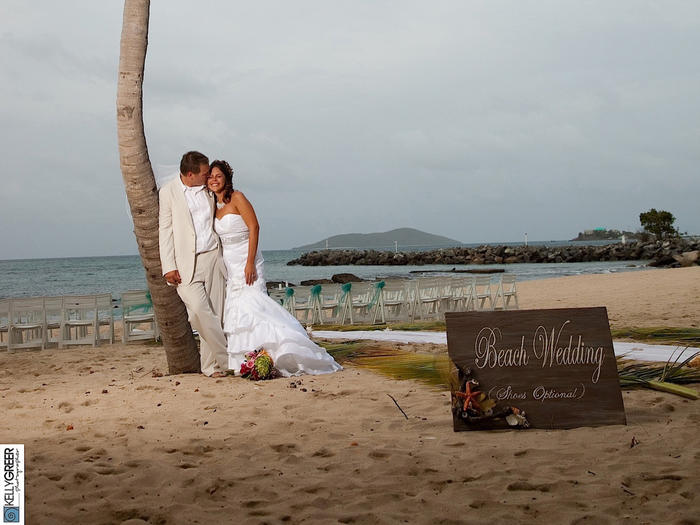 Bride and Groom Under a Coconut tree by the beach at Tamarind Re