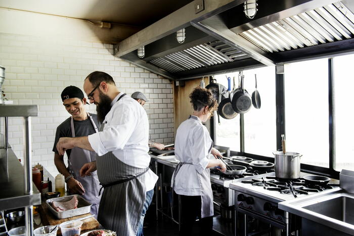 Chefs prepping food in kitchen