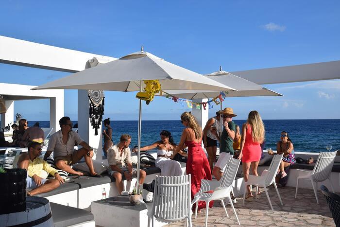 Crowd dancing & drinking on outdoor deck