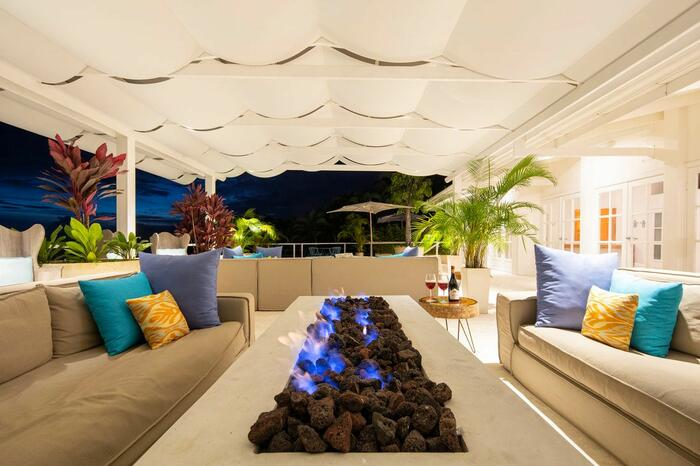outdoor terrace with sofas and fireplace