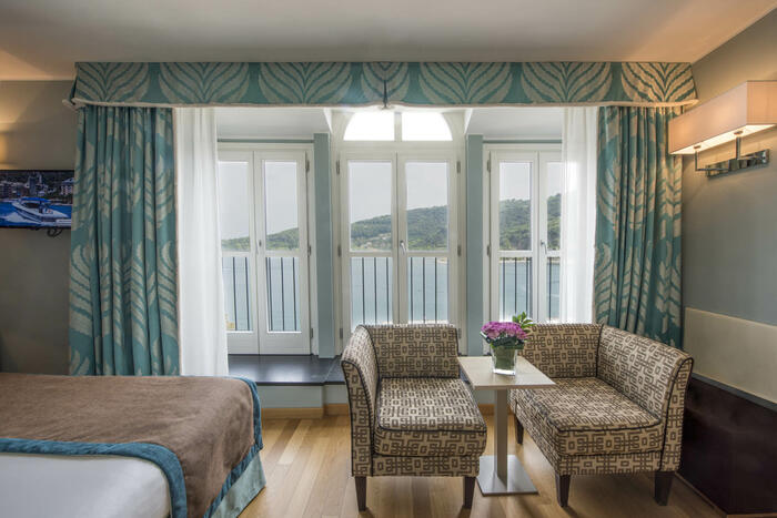 Sofa set inside bedroom-Grand Hotel Portovenere