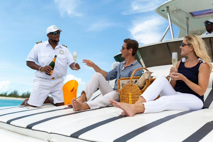 People having champagne in the cruise at Somerset Grace Bay