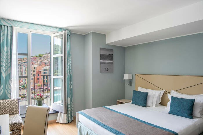 Bed by the window-Hotel Portovenere