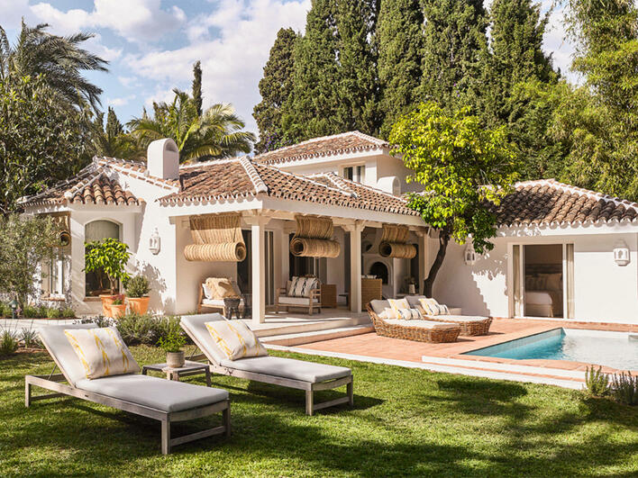Exterior pool view with villa at Marbella Club