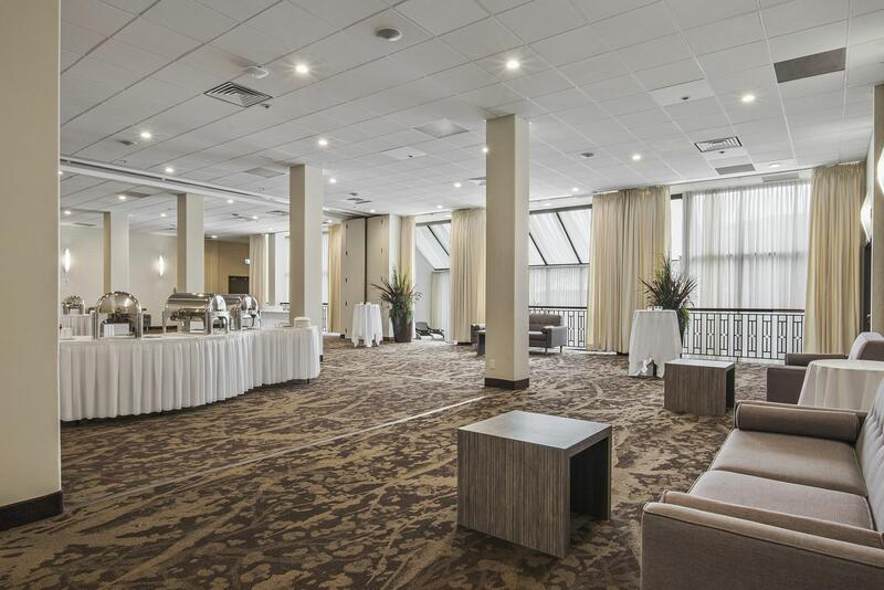 spacious ballroom with buffet setup