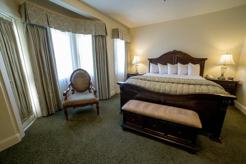 King Bed and chair by window