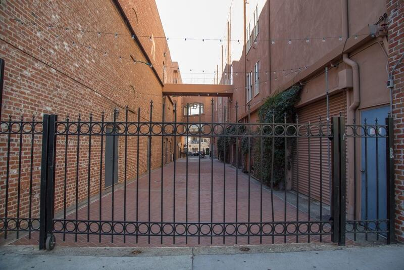 Fenced in brick alley