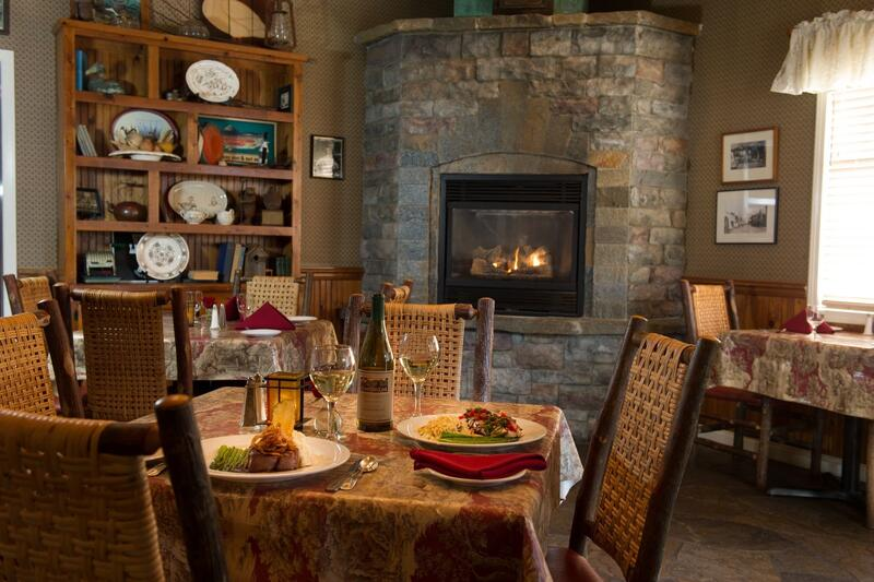 Dinner table with fireplace in the background
