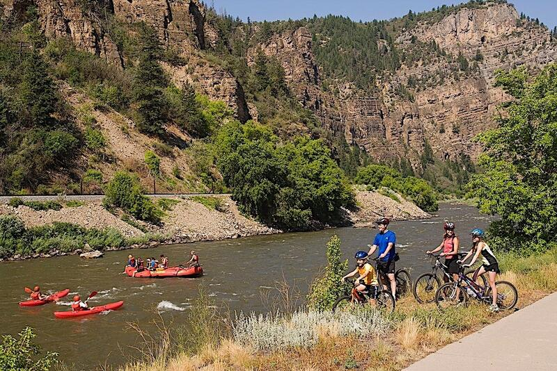 People kayaking and on bikes