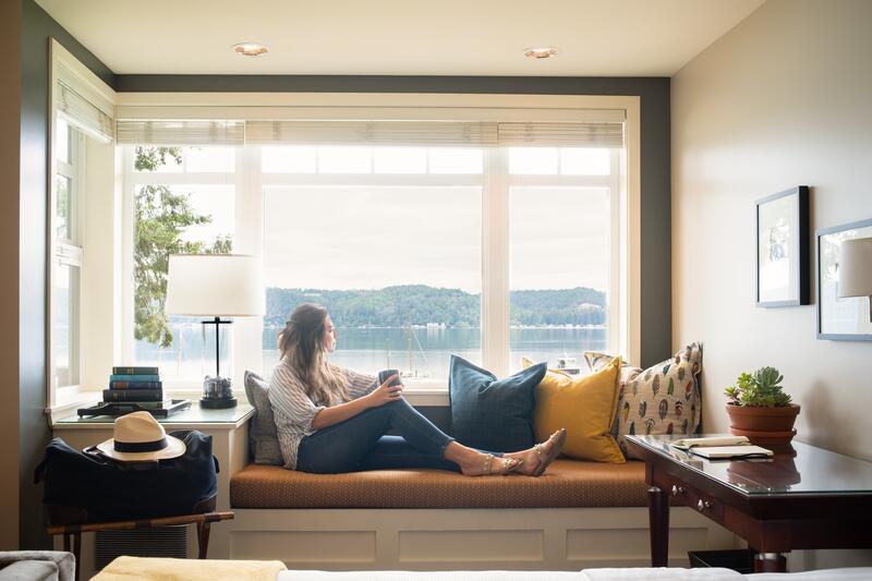 Woman sitting in window seat