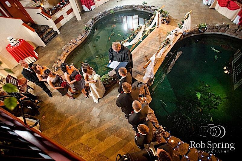 Overhead shot of wedding held over koi pond