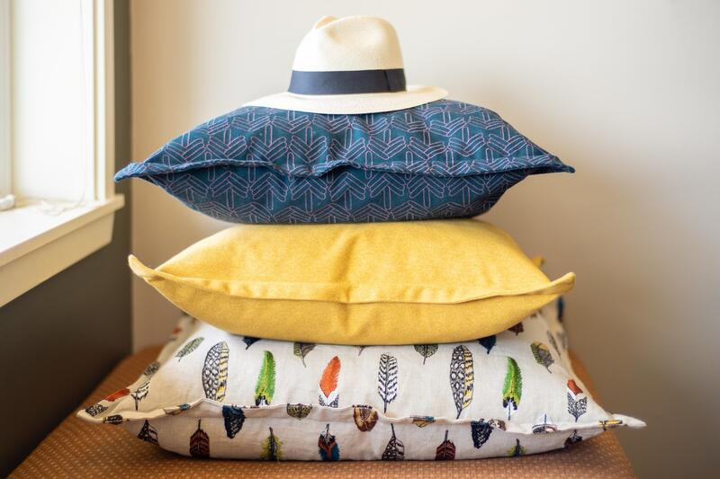 Hat on stack of decorative pillows