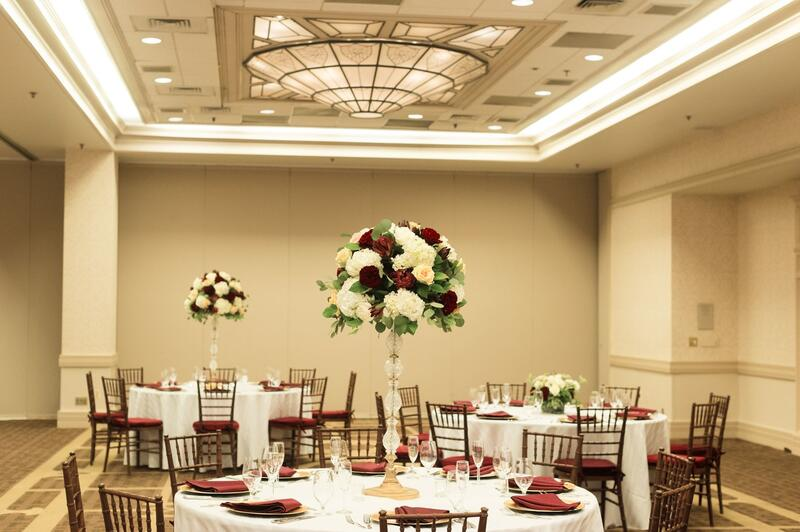 ballroom with tables and rose decorations