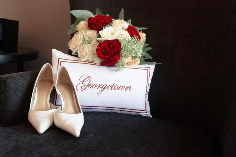 pillow that says georgetown with flowers and heels