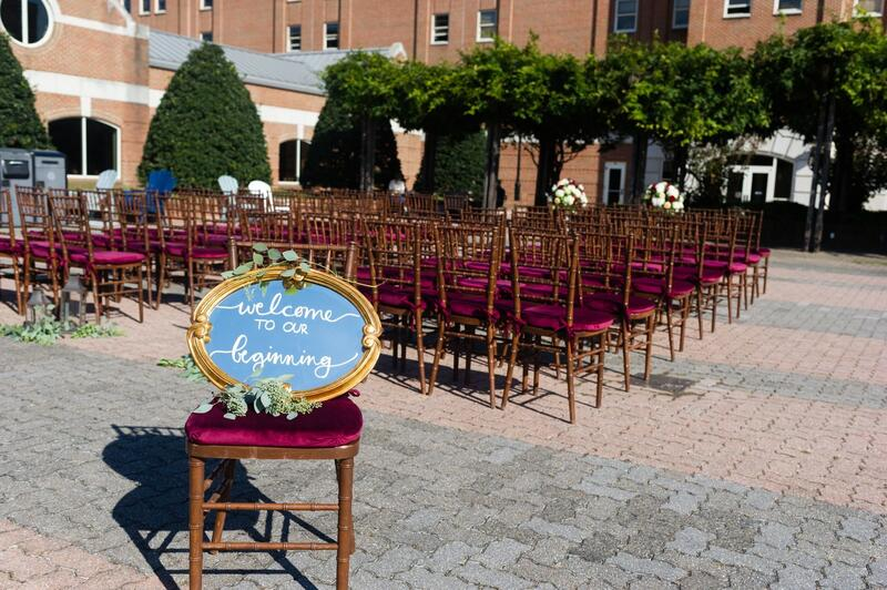 outdoor wedding venue with sign that says welcome to our beginni