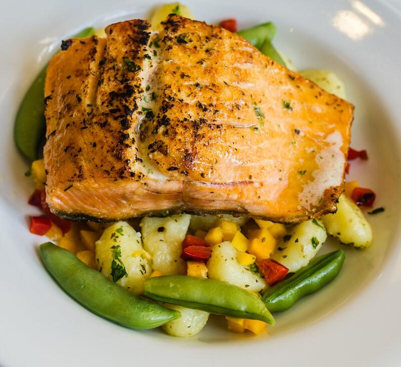 salmon on bed of vegetables