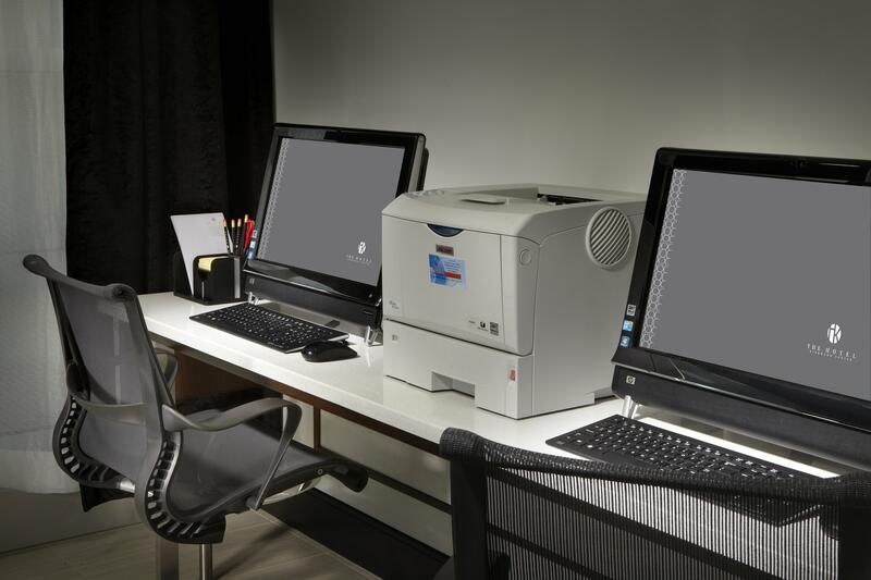 Business center with two computers and printer