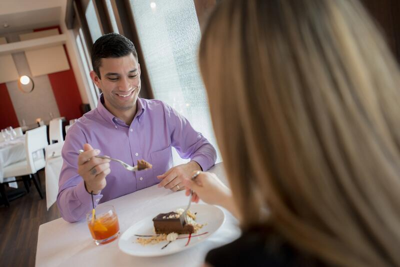 Couple enjoying a meal at a fine restaurant