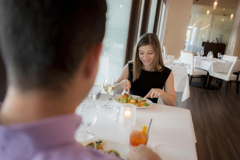 Woman eating dinner in fine restaurant