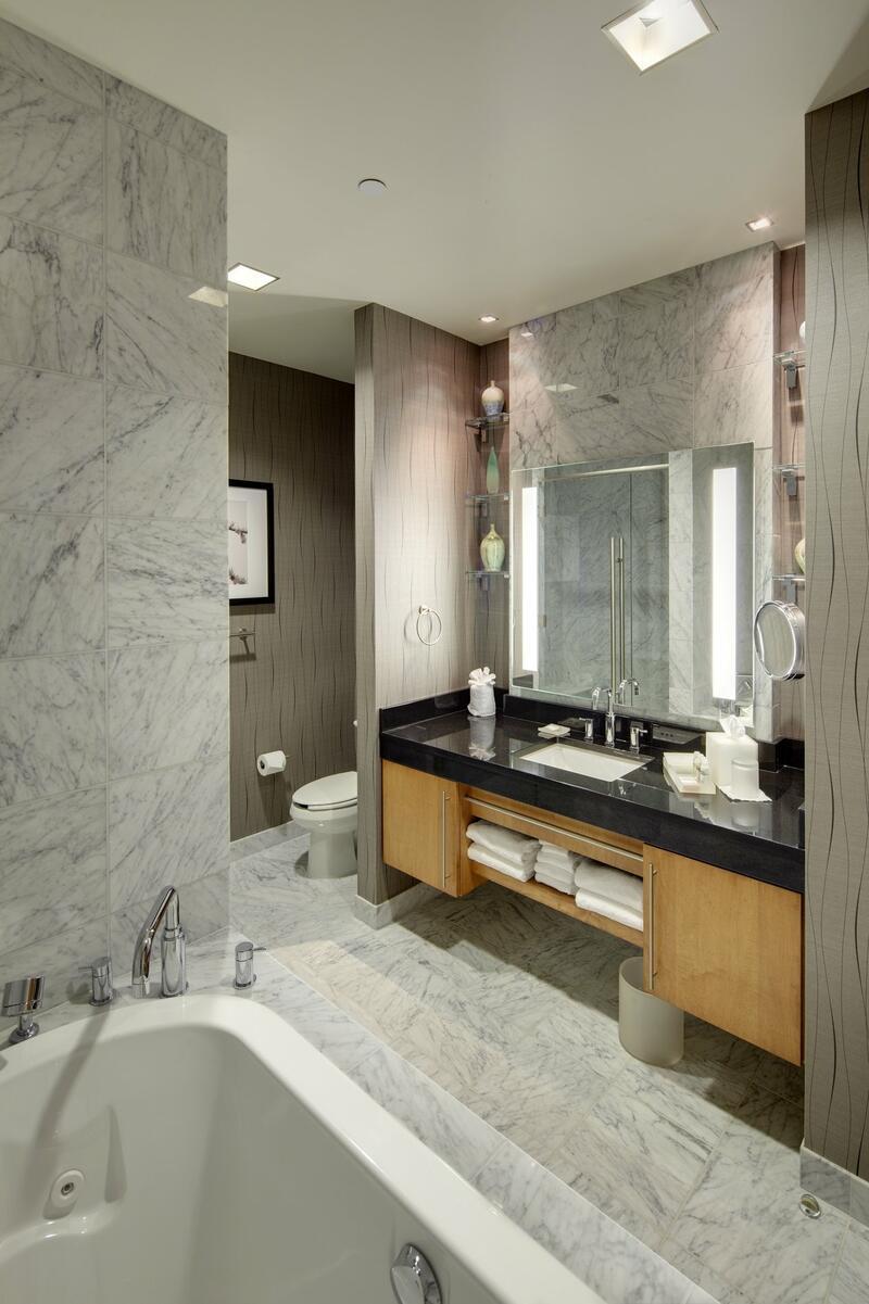 Vast Presidential suite bathroom with marble inlay