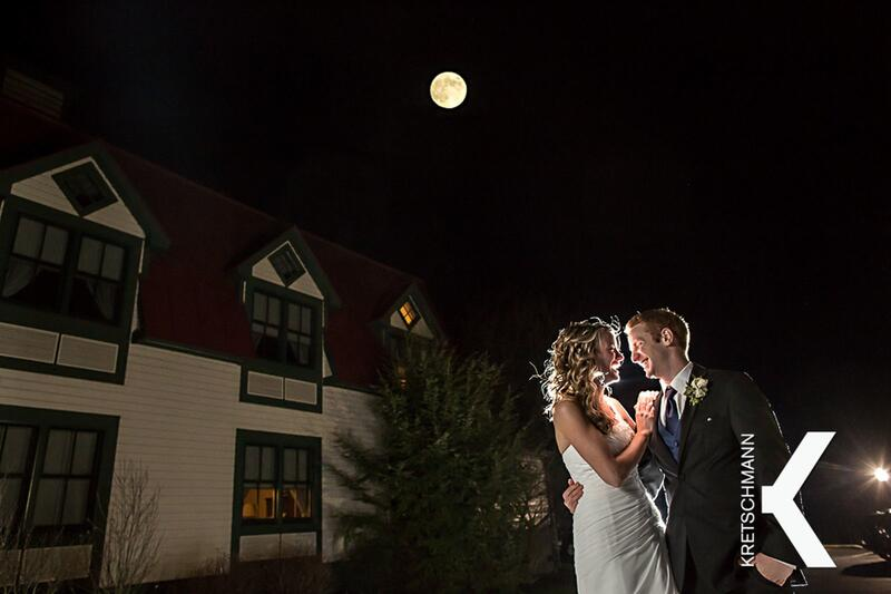 Newly married couple outside under the moon