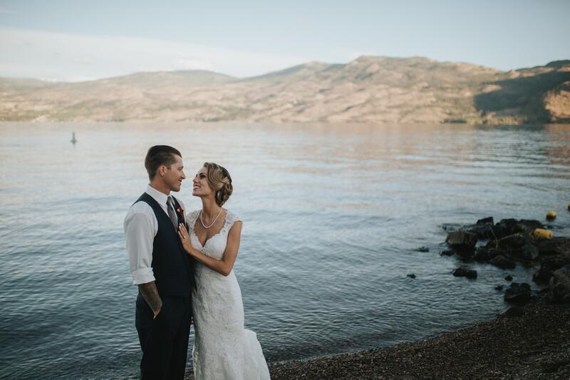 Bride & Groom pose lakefront