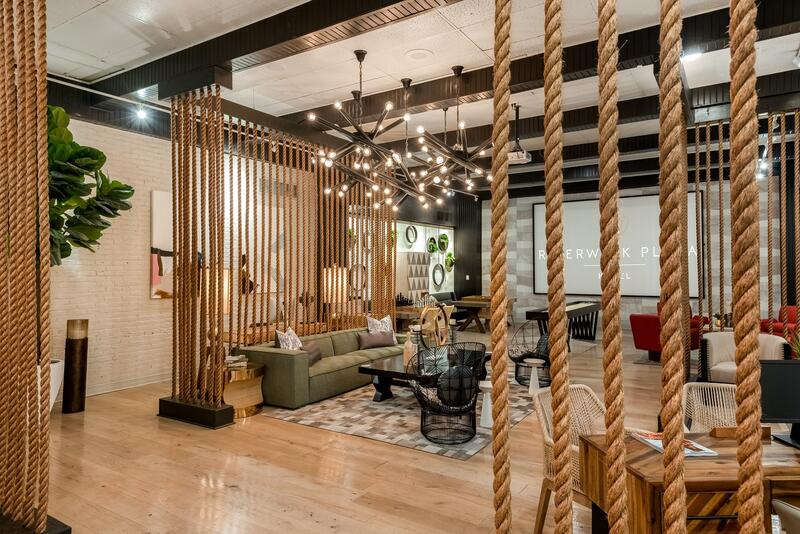 Seating area in lounge with decorative rope accents hanging from