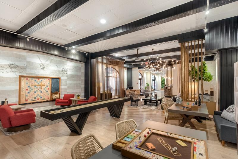 Monopoly game on table, shuffle board and seating in lounge